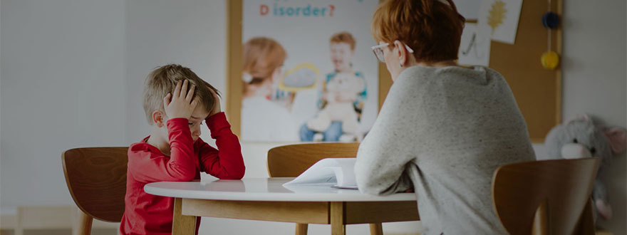 Frustrated child with a teacher
