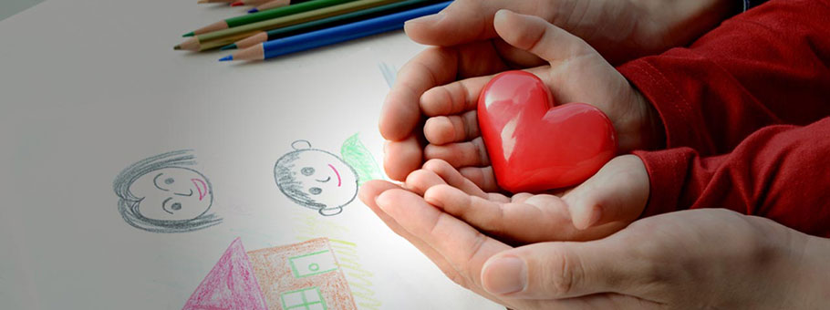 Toy heart in the hands of a child