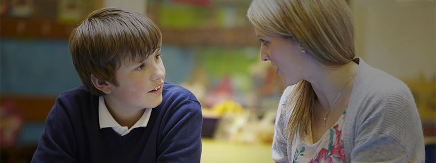 Boy lip-reading his teacher