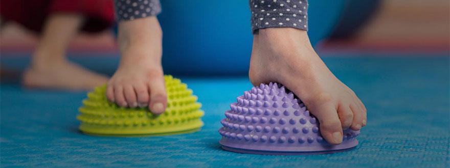 Bare feet on textured half balls