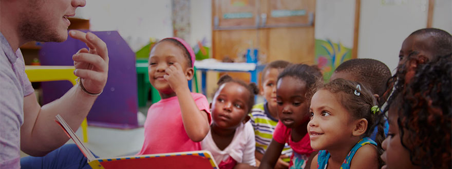 Group of school kids lip-reading a teacher
